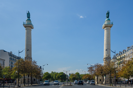 Paris, France, August 29, 2015 - The two Doric columns erected in 1788 on Trone Avenue frame the entrance to Cours de Vincennes and Place de la Nation, the site of a secondary guillotine.