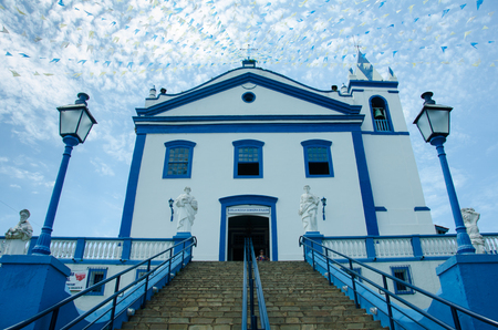 Ilhabela, Brazil, February 24, 2017 - The Catholic church, dating back to the 18th Century, dominates the square of the popular tourist destination for cruise ships.