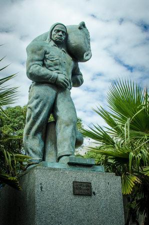 Montevideo, Uruguay, March 4, 2017 – The statue of the stevedore celebrates the dock workers responsible for loading and unloading the ships was created by sculpture L.B. Pagani in 1930.