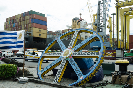Montevideo, Uruguay, March 4, 2017 – The welcome sign at the container port of the capital city is translated into many languages. Banco de Imagens - 79201951