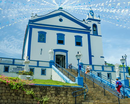 senhora: Ilhabela, Brazil, February 24, 2017 - The Catholic church, dating back to the 18th Century, dominates the square of the popular tourist destination for cruise ships.