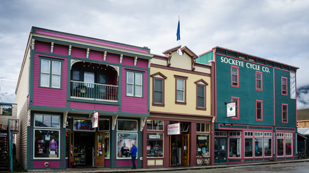Skagway, Alaska, September 10, 2017 - Colorful storefronts line the street in a town that attracted hundreds of prospectors arriving every day by steamer from Seattle during the Klondike Gold Rush.
