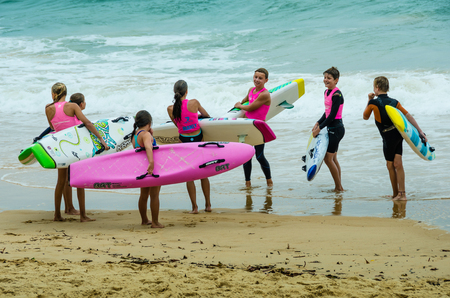 Sidney, Australia, December 21, 2017 -People playing at Main Beach with the surf of the Pacific Ocean.