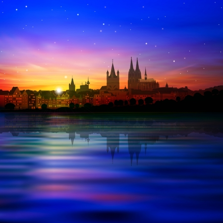 dom: abstract blue background with sunset and silhouette of Cologne