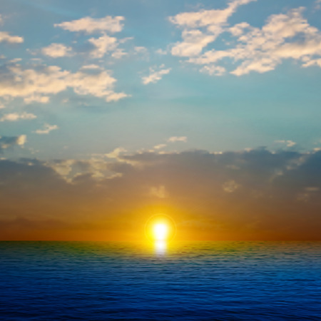 horizon over water: abstract nature background with sea sunset and dark clouds