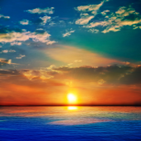 horizon over water: abstract blue nature background with sea red sunset and clouds