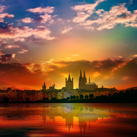 cologne: abstract nature background with red sunset and silhouette of Koln