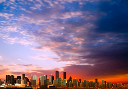 skyline city: abstract sunrise clouds background with panorama of city vector illustration
