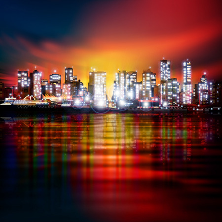 horizon reflection: abstract red background with panorama of illuminated city by night