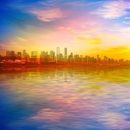 abstract spring background with gold sunset pink sky and silhouette of Vancouver