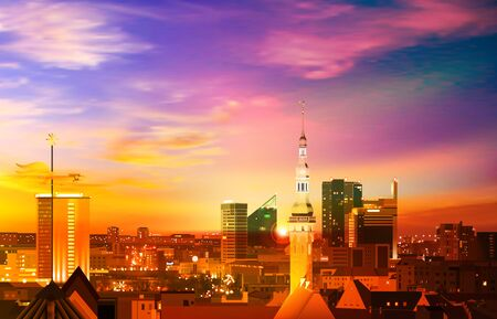 abstract spring background with pink gold sunset and panorama of Tallinn