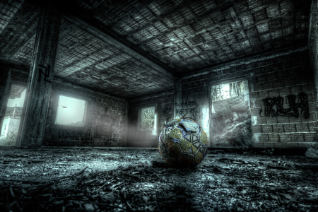 The soccer ball abandoned in the desolate place