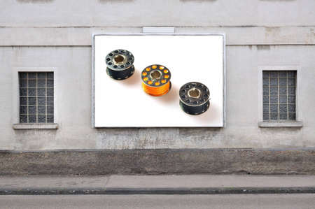 billboard with with sewing threads photo