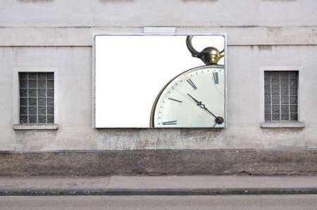 billboard with a vintage pocket watch Stock Photo
