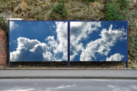 billboard with blue sky and clouds photo