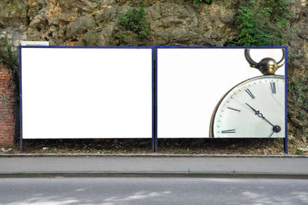 billboard wirh a detail of a pocket watch Stock Photo