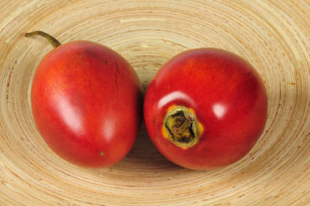 a plate with two tamarillos
