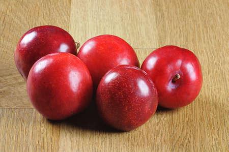 five fresh plums Stock Photo