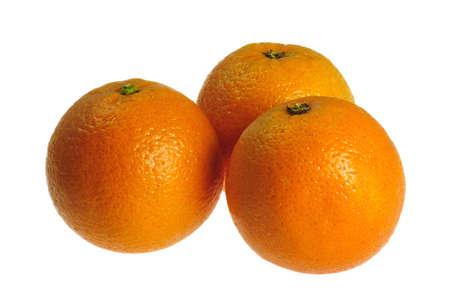 three fresh oranges on white background