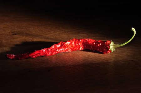 dried chili in the dark illuminated
