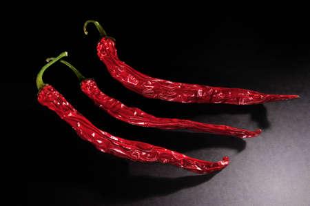 dried chilis in the dark illuminated