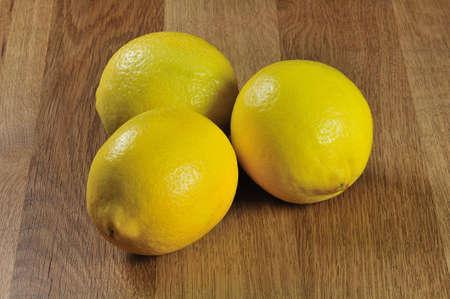 three fresh lemons on the table Stock Photo