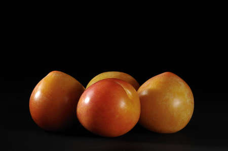 a group of plums in the dark