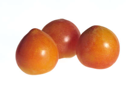 three plums isolated on white background