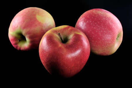 three fresh and red apples
