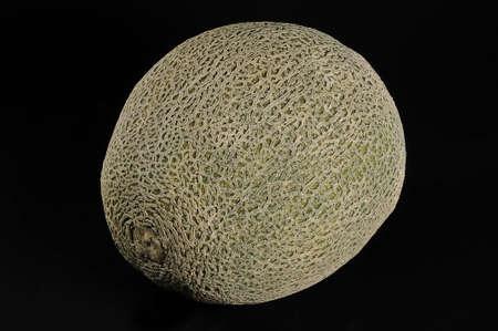 fresh cantaloupe melon on black background