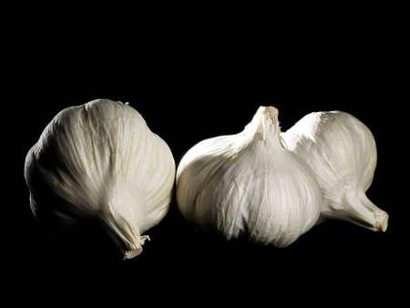 three cloves of fresh garlic Stock Photo