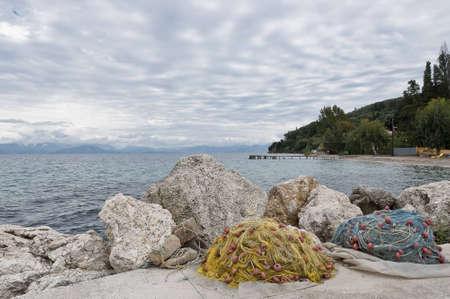 fishing nets in la ittle port in the mediterrean sea Stock Photo
