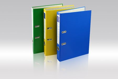 Three business folders on Gray background. Green, yellow and blue. File with paths.