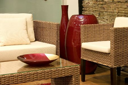 Close up of living room with sofas from rattan and arm chair. photo