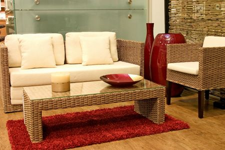 Modern living room with sofas from rattan and arm chair. photo