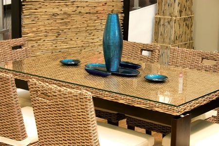 ratten table and chair with blue decorated vase. Stock Photo - 5236293