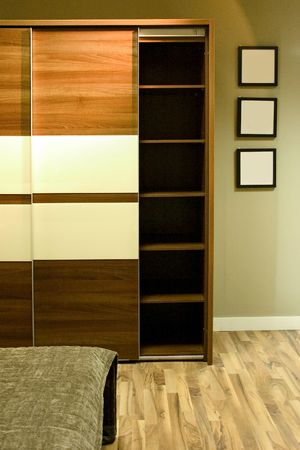 Wardrobe with three frames on the wall. Stock Photo