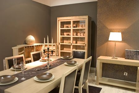kitchen remodelling: Luxury dining room and dinig table with glasses, dishes and furniture. Stock Photo