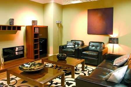 Modern living room with warm colors. Leather sofa, two arm-chairs and a caffee table.  photo