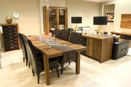 Elegnat dining room with wooden furniture. photo