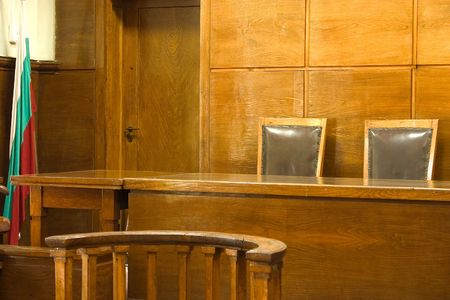 court room: Old vintage court room. Close-up of the judges chairs.
