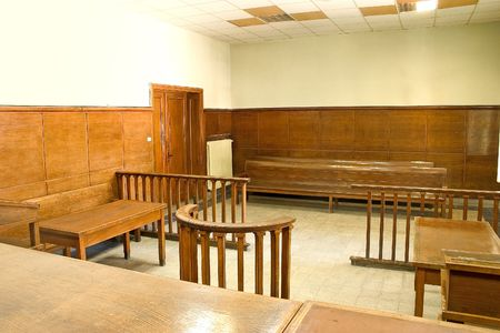 Old vintage court room with wooden furnitures.