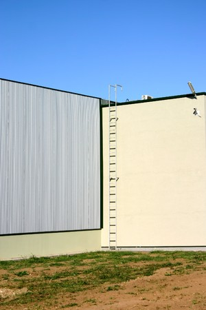 Exterior of industrial building with clear bright colort and blue sky.