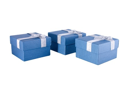 Three blue gift boxes with silver ribbons on it.