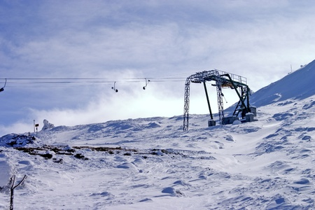 Ski lift  deep in the winter mountain with fresh blue colors.