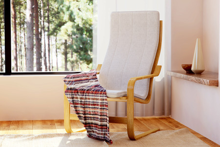 Wooden relaxing chair with rocking function in bedroom interior  Stock Photo