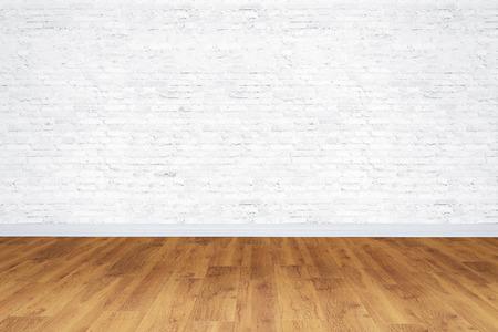 Lege witte stenen kamer met houten vloer