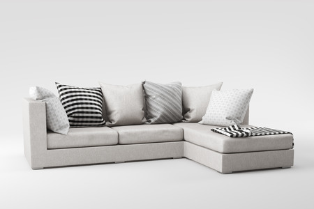 White fabric sofa with pillows isolated on white background.