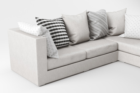 Closeup of white fabric sofa with pillows isolated on white background. Stock Photo