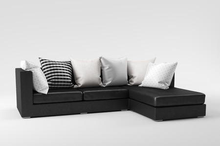 Black leather sofa with pillows isolated on white background.